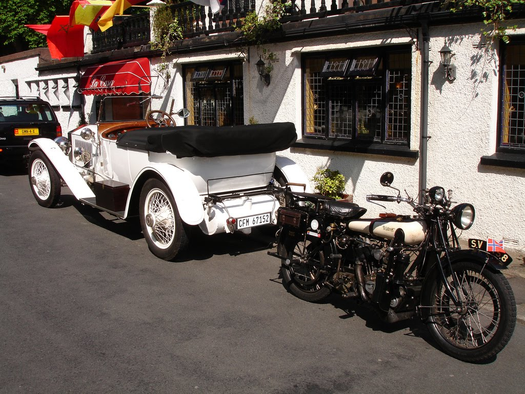 Rolls Royce and a Brough.